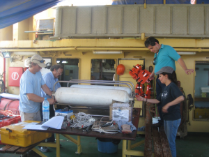 Members of the University of Texas Institute for Geophysics (UTIG) and National Autonomous University of Mexico (UNAM) prepare the boomer system for deployment off the R/V Justo Sierra on the Campeche Bank. (Photo courtesy John Goff)