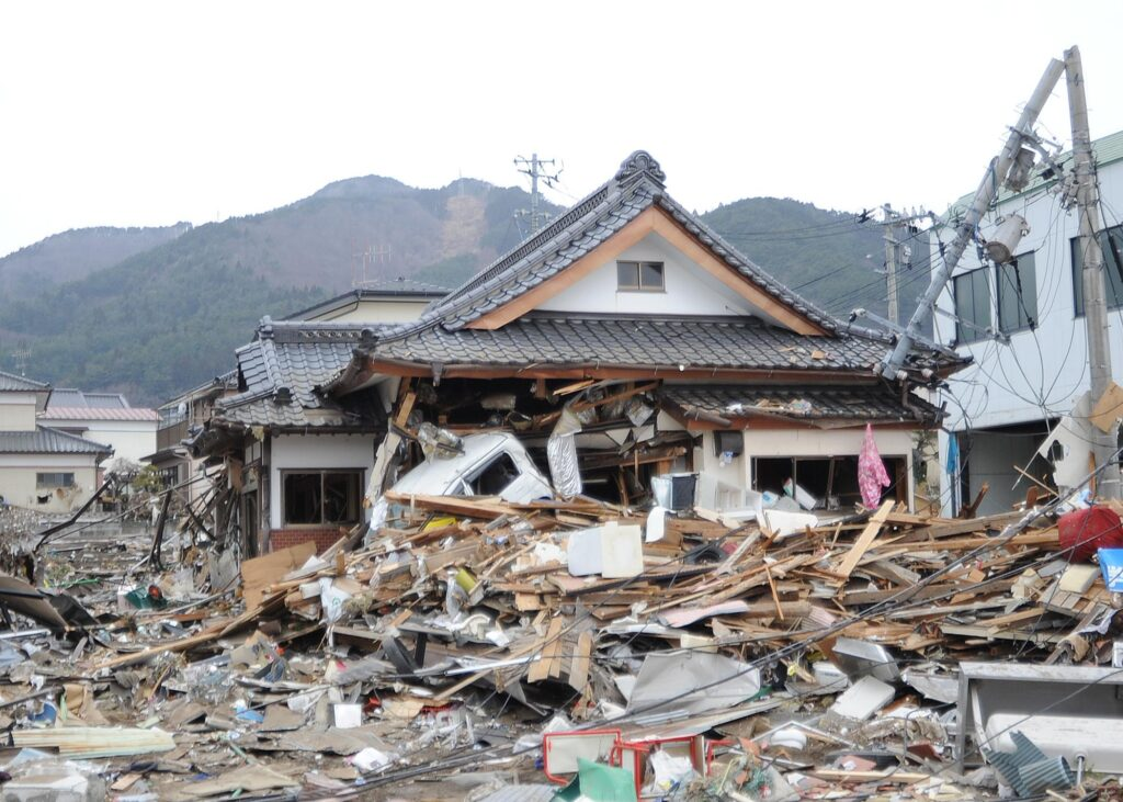 Picture of a ruined house surrounded by debris